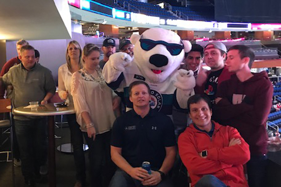 Clymer Farner Barley group picture of team members at sports game.