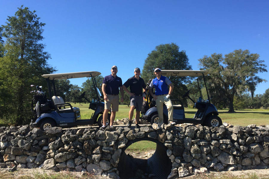 Clymer Farner Barley group picture of team members golfing.